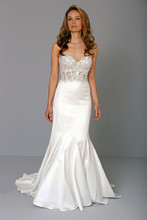 Sweetheart Mermaid Gown in Satin This mermaid gown features a sweetheart neckline with a natural waist in satin and beaded embroidery. It has a chapel train. This gown is Exclusive to Kleinfeld Bridal. Style Number:32711038