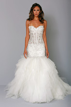 Sweetheart Mermaid Gown in Beaded Embroidery This mermaid gown features a sweetheart neckline with a dropped waist in beaded embroidery and silk organza. It has a chapel train and spaghetti straps. This gown is Exclusive to Kleinfeld Bridal. Style Number:32744187