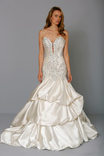 Sweetheart Mermaid Gown in Silk Charmeuse This mermaid gown features a sweetheart neckline with a dropped waist in silk charmeuse and beaded embroidery. It has a chapel train and spaghetti straps. This gown is Exclusive to Kleinfeld Bridal. Style Number:32711004