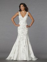 Style 32838229 This mermaid gown features a v-neck neckline with a dropped waist in beaded embroidery and tulle. It has a chapel train and a tank top. This gown is Exclusive to Kleinfeld Bridal.
