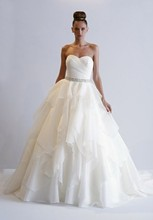 Style 32819674  This a-line gown features a sweetheart neckline with a natural waist in silk organza and beaded embroidery. It has a chapel train. This gown is Exclusive to Kleinfeld Bridal.