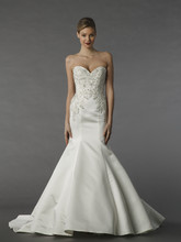 Style 12075  This mermaid gown features a sweetheart neckline with in satin and beaded embroidery. It has a chapel train.