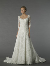 Style 12076  This a-line gown features a scoop neckline with in chiffon and embroidery. It has a chapel train and 3/4 length sleeves.