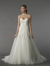 Style 12077  This a-line gown features a sweetheart neckline with in tulle and beaded embroidery. It has a chapel train.