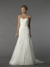 Style 12079  This a-line gown features a sweetheart neckline with a natural waist in tulle. It has a chapel train.
