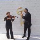 130x130 sq 1348247727516 violinandflute