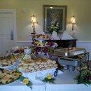 130x130 sq 1305247604279 diningroom