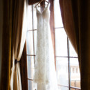130x130 sq 1379035517219 dress hanging in window