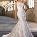 D1209 Glimmering Swarovski crystal embellishments, delicate lace accents, slimming satin waist details, and a detachable one shoulder jacket make this lace over Dolce Satin trumpet gown a must on your wedding day. Lace up or zipper bodice available. Semi-cathedral train.