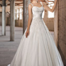 D1249 Fit for a princess, this Soft Organza over Dolce Satin wedding ball gown features delicate embroidery with jewel accents on a sweetheart bodice. Figure flattering crisscross satin ruching at the waist add interest. Lace up or zipper back available.
