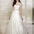 D1450 This exquisite Dolce Satin wedding gown features soft ruched bands of satin and gorgeous Diamante details on its elegant bodice. The skirt features striking asymmetrical A-line pleats that cascade into a traditional chapel train. Choose from a lace up or zipper back. Sparkling beaded belt available separately.