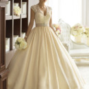 "D1606 For brides looking for classic wedding dresses, Essense of Australia offers this Regal Taffeta ball gown wedding dress with an elegant detachable Diamante beaded jacket. Under the illusion jacket, you'll find a lovely fitted sweetheart bodice that gathers at the waist with a figure-flattering 2"" Grosgrain ribbon sash. Below the sash, the rich Regal Taffeta gives way to a full skirt and train. The back zips up under crystal buttons that carry-through to the floor."