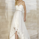 D1399 For the fashion forward bride, this gorgeous high-low hemline slim designer gown features ruched tulle on its bodice, a sweetheart neckline, scalloped lace edging on the skirt, and a beautiful band of Swarovski crystals at the natural waist.