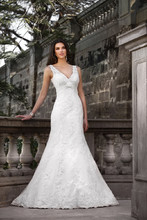 D988 This stunning designer wedding gown features Diamante and lace details on a fit-and-flare silhouette of lace and luxurious taffeta. Dress features illusion lace tank straps, a ruched empire waist band, and a low V-neck back. Lace up or zipper bodice available.