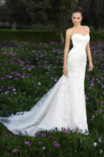 D1181 This vintage-inspired lace over Dolce Satin trumpet gown makes a statement of sophistication on your special day. It features a true sweetheart neckline, detachable satin sash and a lady-like court train. Lace up or zipper back available.