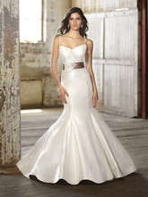 D1367 This lavish Luxe Taffeta fit-and-flare designer wedding dress features a romantic removable lace overlay and dramatic low back. Sexy V-neck neckline and detachable French-wide satin sash add wow to this breathtaking ensemble.