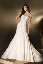 D1408 All glitz. All glam. This designer slim-line wedding gown in Luxe Taffeta features stunning crystal appliqués on the bodice, a sweetheart neckline, and asymmetrical pleats on the hip. Pleats continue down the skirt into a chapel train. Lace up or zipper back available.