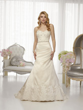 D1455 This Dolce Satin designer wedding gown offers superb fit and couture finishing with its intricate, hand-sewn Diamante jewel embellishments and figure-flattering asymmetrical pleating. Skirt flows full into a chapel train and features a scalloped lace hem. Lace up or zipper back available.