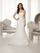 D1474 This lace over tulle designer wedding gown boasts a fashion-forward trumpet silhouette, scalloped lace edging on its sweetheart neckline and hem. Detachable Grosgrain ribbon sash included. Detail options include a stylish, detachable peplum.