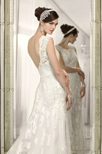 D1549 This designer sheath wedding gown features a vintage-inspired lace overdress with cap sleeves and Diamante crystals. A spaghetti strap silky Dolce Satin gown hides underneath. Gown available to be ordered with or without lace overdress.