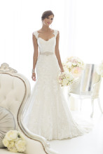D1617 This beautiful all-over Lace fit and flare wedding gown features sparkling Diamante beading throughout and romantic cap sleeves. Comes in ivory or white Lace over a variety of Dolce Satin underdress color choices. Customize your gown to best reflect your sophistication and unique style with the included 1.5