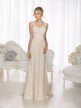 D1673 Influenced by the fashion houses of Europe, this designer sheath wedding dress embraces the