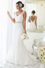 """D1695 For brides looking for that figure-flattering wedding dress, Essense of Australia has created this fit-and-flare gown with hand-sewn Diamante beading on Lace over Lavish Satin. At the top, the dress features illusion Lace shoulder straps covering a sweetheart neckline. At the knees, the dress blooms out and is finished with scalloped Lace on the hem and train. The back zips up under crystal buttons and features a heart-shaped keyhole back. Make this dress your own with a 1.5"""" Grosgrain ribbon sash in your choice of fashion-forward colors."""