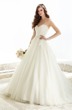 D1706 Full of magic and movement, this Lace and Tulle over Dolce Satin ball gown features a detachable beaded Tulle peplum to bring your big day a visual balance of classic and chic. The sweetheart neckline and fitted bodice boast your choice of white or ivory beading, and the back zips up under sparkling crystal buttons. Choose from Lace in ivory or white with additional Tulle and Dolce Satin color combinations.