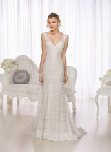 D1726 A modern take on a vintage favorite, this sheath gown from the Essense of Australia designer wedding dress collection features elegant Lace illusion shoulder straps and a scalloped lace keyhole back and hem. The bodice and skirt carry-through the Lace look over a buttery soft Lustre Satin sweetheart gown. The back zips up under crystal buttons. Choose from ivory Lace over Lustre Satin in café or ivory; or go the more traditional route with true white Lace over white Lustre Satin.