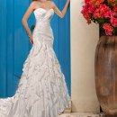 5638 This designer fit and flare wedding dress is crafted with Satin Chiffon and features a stunning sweetheart neckline. The figure-flattering ruched bodice is detailed with Lace accents leading to a tired ruffled skirt that flows and delights.