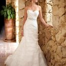 5684 This Dolce Satin A-line wedding dress has a stunning, tiered Organza skirt, a classic shape with a contemporary flare. The included elegant beaded belt is detachable and is the perfect accent to this beautiful design.