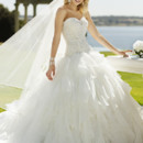 5826  <br /> This beautiful Organza and Tulle designer ball gown features a figure-flattering drop waist and billowy soft waterfall skirt. Diamante crystals on its fitted bodice add charm.