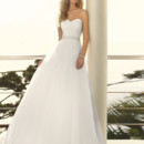 Style 5504 -You've dreamed of this day, now live it in this fairytale-come-true princess designer ball gown made of Soft Organza. This wedding dress is designed with a beautiful and dainty sweetheart neckline. The gown's bodice offers ruching throughout and has an amazing detachable Diamante beaded belt that gives everyone's waist the attention it deserves.