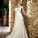 Style 5648 - Graceful and glamorous, this designer sheath wedding gown is crafted with Satin Chiffon and features lovely Lace accents and a stunning beaded single-shoulder strap you can detach if you choose.