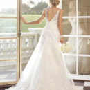 Style 5751 - Fall head over heals for this Dolce Satin wedding gown with soft lace overlay. It's romantic, feminine and classy all in one. Beautiful beaded straps complete the look.