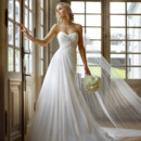 Style 5757 - Flowing and airy is the spirit of this amazing Chiffon gown. Its sweetheart neckline leads to a lovely ruched bodice encrusted with crystal and Lace detailing.