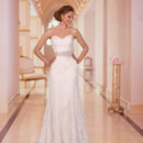 """Style 5939 - Wedding dresses with Lace are perfect for almost any style of wedding and were all the rage on the wedding red carpets this season. Dazzle on your big day by choosing this stunning Lace with Diamante beading strapless sweetheart A line wedding dress from the Stella York wedding dress collection. This slim, sheath wedding dress with Lace come in your choice of romantic ivory Lace over ivory or cafe, or a more traditional look of white over white. Add a pop of color with an ivory, black, sterling, or latte colored 2"""" Grosgrain ribbon sash with Diamante beading."""