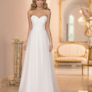 6010 The perfect dance between sophistication and simplicity, this Stella York princess-inspired strapless A-Line wedding gown features a beautiful bodice accented with crystal clear beading. You'll love how the sweetheart neckline frames your face, while the figure-flattering fitted bodice flows into a whispery soft skirt at the natural waist. The back zips up under sparkling buttons and features a court train. Choose from traditional white or off-white Tulle.