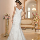 5948 Bring dramatic elegance and Australian-inspired sophistication to your special day with this fit-and-flare silhouette with a court train from the Stella York wedding dress collection. The handcrafted Diamante beaded Lace details create an illuminating presence, while the sweetheart neckline and cap sleeves frame the face beautifully. The back zips up under crystal buttons. Choose from ivory and silver Lace over Satin in ivory, or white and silver Lace over white Satin.