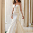 5980 Looking for a chic fit-and-flare wedding dress? You'll be a blushing bride in this strapless Dolce Satin wedding gown from the Stella York collection. It features gorgeous Diamante embellishments at the bust and knee, as well as rich Asymetrical ruching throughout. The back features a corset closure and a beautiful chapel train. Choose from Dolce Satin in ivory, white, oyster, and pewter.