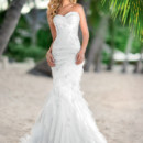 Style 5468 - This designer mermaid silhouette wedding gown boasts a sweetheart neckline and is beautifully crafted with Soft Organza rouching and vertical tiers. Beaded lace appliques add subtle sparkle