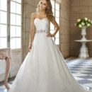 Style 5711 - This Soft Organza designer wedding gown has a figure flattering ruched bodice and a feminine sweetheart neckline. These features are complemented by a delicately beaded sash with soft cascading ruffles down the back of the gown's skirt.