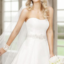 5722 This amazing Luxe Taffeta strapless gown comes with a stunning beaded sash and lavish button details along the dress's train. You will love that this gown is perfected with pockets.