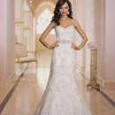 Style 5838 - Long, narrow and oh-so slim-fitting, this sheath wedding dress with hand placed elegant Lace over Dolce Satin from the Stella York collection is the epitome of sexy. You'll love how the hand beaded Diamante embellishments sparkle under soft light. Additional details include a lovely sweetheart neckline, scalloped lace hem, sparkly beaded belt, traditional court train, and a zipper back hidden under sparkling crystal buttons.