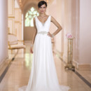 Style 5876 - A twist on tradition, this elegant sheath wedding dress from the Stella York designer wedding dress collection offers a modern spin on a simple form inspired by the Grecian era. You'll love the unique features of this sheath wedding dress - Diamante beading peaks from underneath its sexy V neckline and carries through on the shoulder straps, upper back detailing and fitted waist, while the bust features twisted Chiffon that gathers at the natural waist and then transforms into minimalistic pleating down through the skirt and court train. The modified keyhole - V-back zips up under crystal buttons.