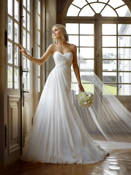 5757 Flowing and airy is the spirit of this amazing Chiffon gown. Its sweetheart neckline leads to a lovely ruched bodice encrusted with crystal and Lace detailing.