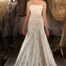 414 Fit-and-flare designer wedding gown features an optional embroidered floral lace jacket with illusion bateau neckline. Silk bodice boasts a sweetheart neckline with hand tailored silk flower appliques and lightly pleated dropped waist. Lace up or zipper back available.