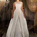 424 Designer wedding ball gown features a detachable lace illusion jacket and vintage lace skirt.  Silk under-dress is a strapless fit-and-flare silhouette. Available to purchase in multiple options. Lace up or zipper back available.