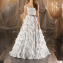 377 A-line designer wedding gown in Parisian Silk Chiffon features encrusted Swarovski crystals, diamantes and freshwater pearls on the scalloped sweetheart bodice to the natural waist and a dramatic textural skirt. Valencia satin ribbon sash included. Zipper back closure with fabric buttons.