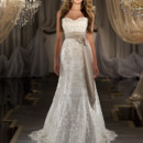 419 Sheath style lace wedding gown with sweetheart neckline features Swarovski Crystal beading throughout. Lace up or zipper back. Grosgrain ribbon sash sold separately.